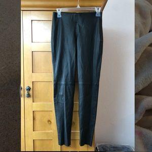 Black faux leather material leggings